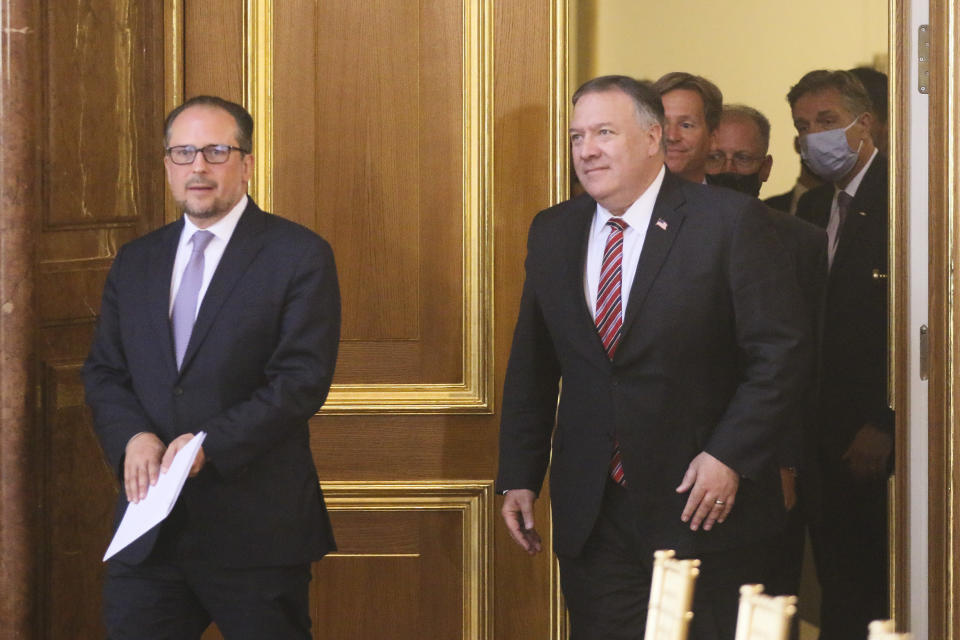 US Secretary of State Mike Pompeo, center left, attends a joint news conference with Austrian Foreign Minister Alexander Schallenberg, center right, in Vienna, Austria, Friday, Aug. 14, 2020. Pompeo is on a five-day visit to central Europe. (AP Photo/Ronald Zak)