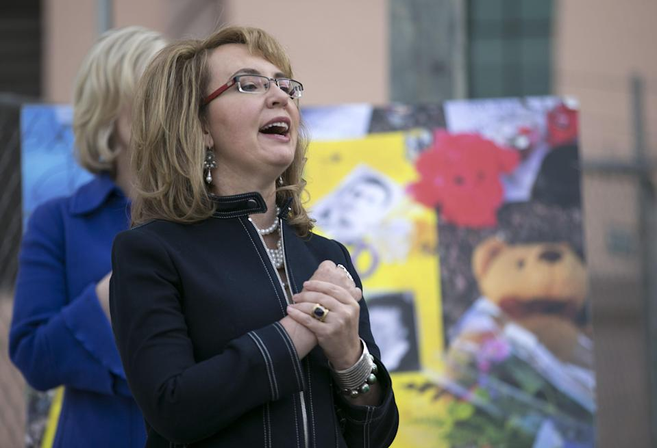 Former Rep. Gabrielle Giffords sings National Anthem at dedication for the January 8th Memorial at El Presidio Park in Tucson, Ariz., on Jan. 8, 2018.