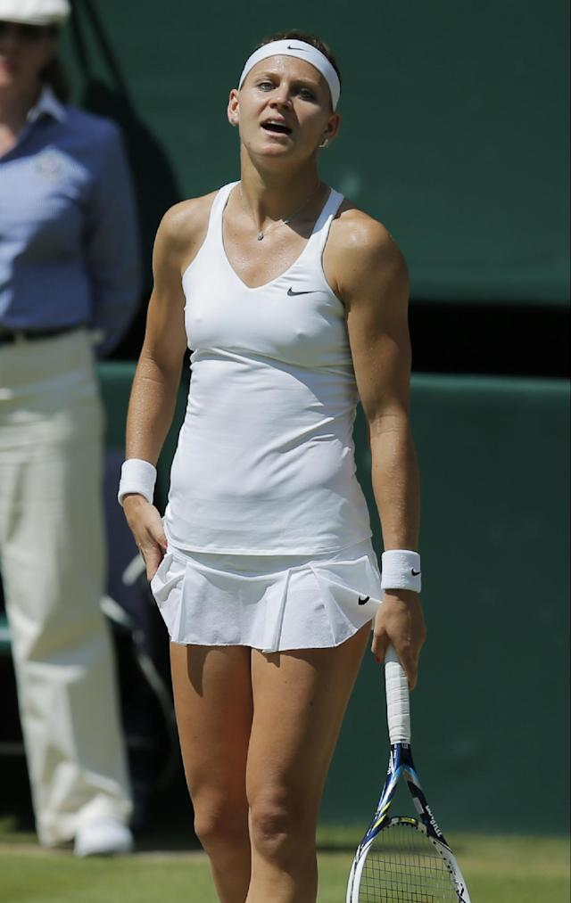 Lucie Safarova of Czech Republic reacts after losing a point to Petra Kvitova of Czech Republic during their women's singles semifinal match at the All England Lawn Tennis Championships in Wimbledon, London, Thursday, July 3, 2014. (AP Photo/Pavel Golovkin)