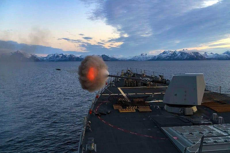 The guided-missile destroyer USS Gridley (DDG 101) fires its Mark 45 5-inch gun during a live-fire exercise.