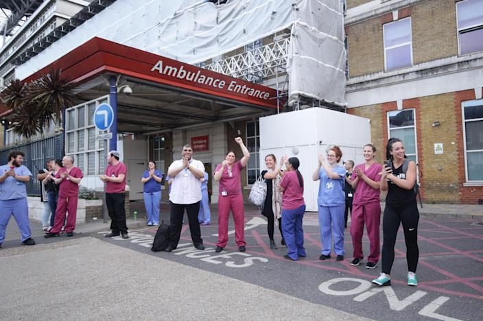 NHS staff outside King's College Hospital in Camberwell, south London, join in the applause to salute local heroes during Thursday's nationwide Clap for Carers to recognise and support NHS workers and carers fighting the coronavirus pandemic.