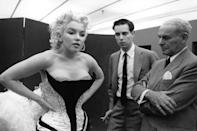 <p>Marilyn gets fitted for her costume before riding a pink elephant in Madison Square Garden fir a circus charity event in March.<br></p>