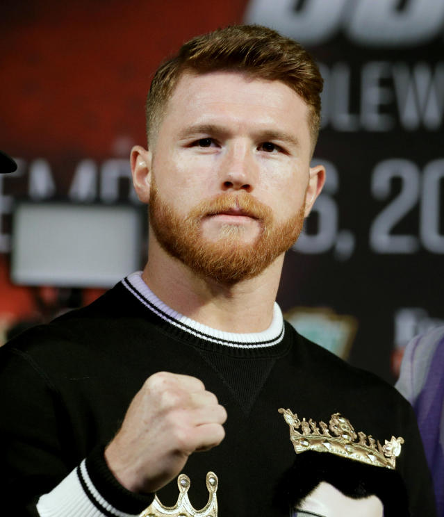 FILE - In this Sept. 13, 2017, file photo, Canelo Alvarez attends a news conference in Las Vegas. Nevada boxing regulators have suspended Canelo Alvarez for six months for doping violations. Neither Alvarez nor representatives from Golden Boy Promotions appeared Wednesday, April 18, 2018, during the Nevada Athletic Commission's monthly meeting, where the suspension was handed down (AP Photo/John Locher, File)