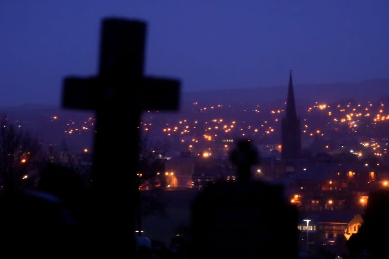 FILE PHOTO: A general view shows night falling on the city of Londonderry