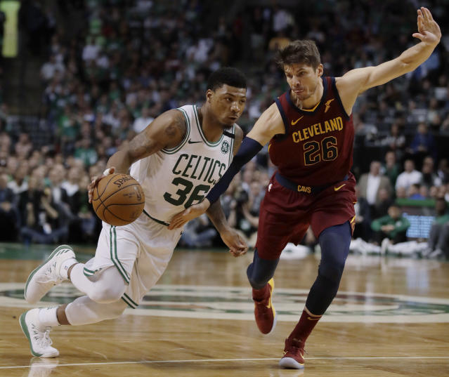 Marcus Smart drives against the Cavs' Kyle Korver during the second half of Game 2 Tuesday night. (AP)