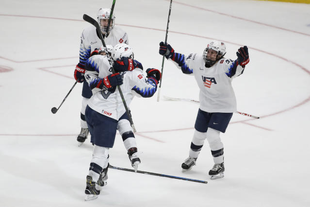 U.S. players celebrate Megan Bozek's overtime goal against Canada in a Rivalry Series hockey game in Anaheim, Calif., Saturday, Feb. 8, 2020. The United States won 4-3 and won the series. (AP Photo/Chris Carlson)