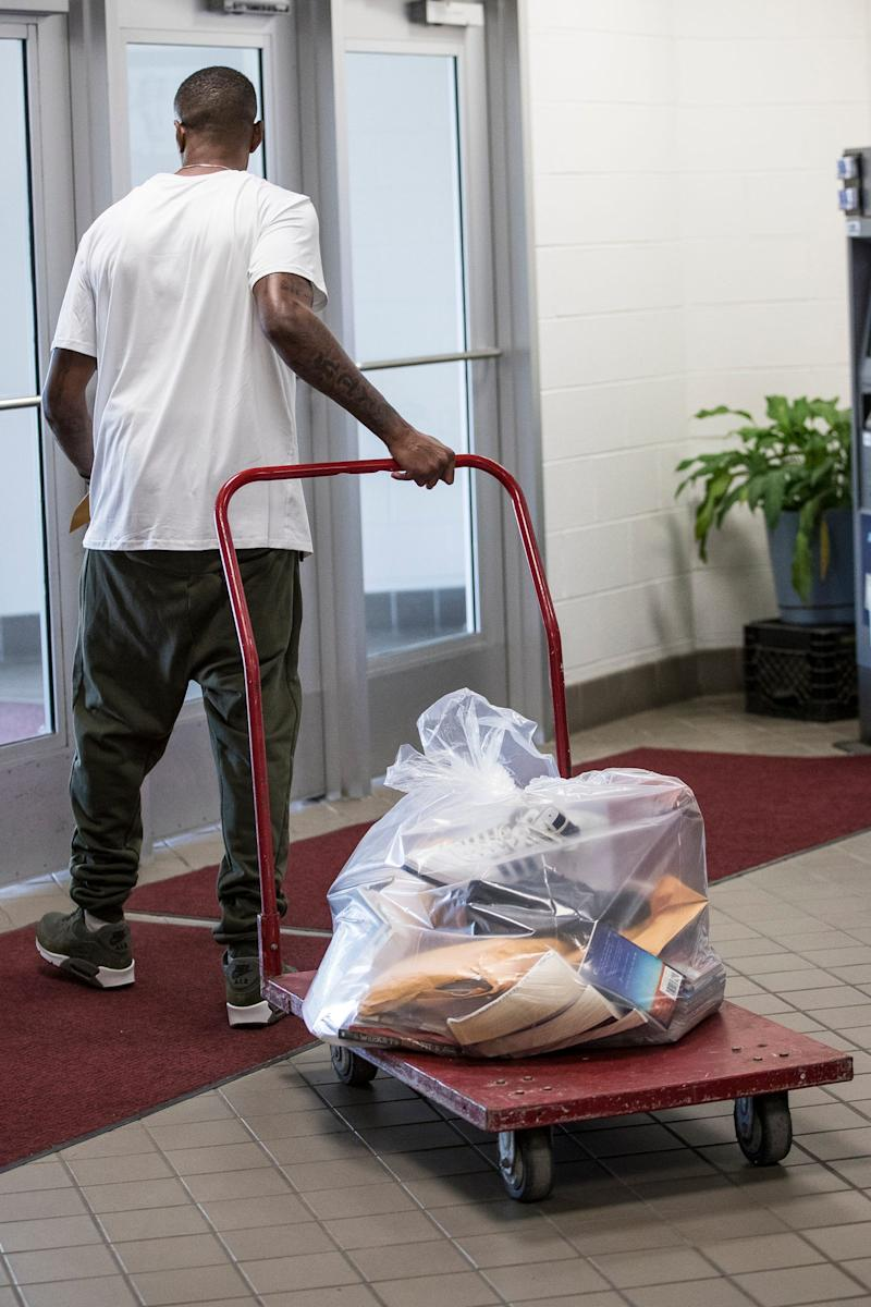 James Chad-Lewis Clay takes his belongs as leaves the Macomb Correctional Facility in Lenox, Tuesday, July 23, 2019.