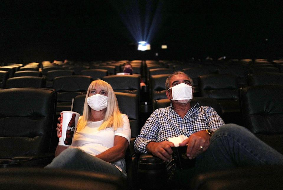 <p>Patrons watch a movie at AMC DINE-IN Thoroughbred 20 on August 20 in Franklin, Tennessee.</p>