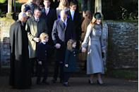 <p>Following their annual tradition, the royal family attended Christmas Day church services at Sandringham. Here, Prince William, Catherine, Duchess of Cambridge, Prince George, and Princess Charlotte hold hands while heading to church. </p>