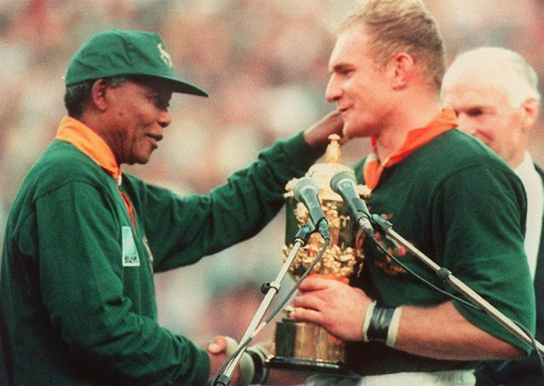 The All Blacks were red-hot favourites in the 1995 Rugby World Cup final but South Africa had a secret weapon in political prisoner-turned-president Nelson Mandela (AFP/PHILIP LITTLETON)