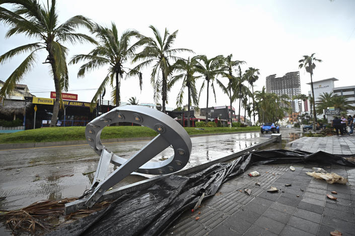 Toppled lamp posts lay on the side of a road after the passing of Hurricane Pamela in Mazatlan, Mexico, Wednesday, Oct. 13, 2021. Pamela made landfall on Mexico's Pacific coast just north of Mazatlan on Wednesday, bringing high winds and rain to the port city. (AP Photo/Roberto Echeagaray)