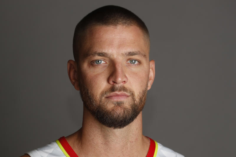 """FILE - In this Oct. 3, 2019, file photo, Atlanta Hawks' Chandler Parsons poses during an NBA basketball media day in Atlanta. Parsons' attorneys say the Hawks forward suffered severe and permanent injuries"""" in a car wreck last week that could jeopardize his career. (AP Photo/John Bazemore, File)"""