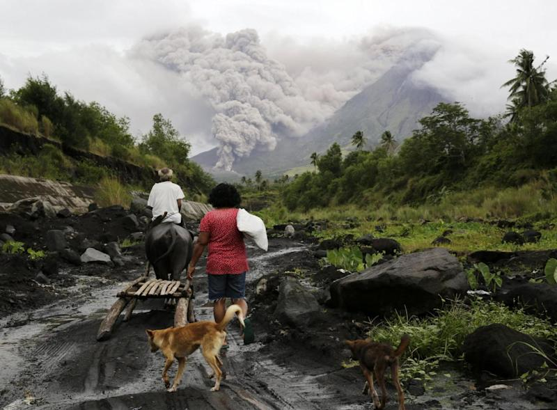 Mayon: Stunned villagers watch the ash plume (EPA)