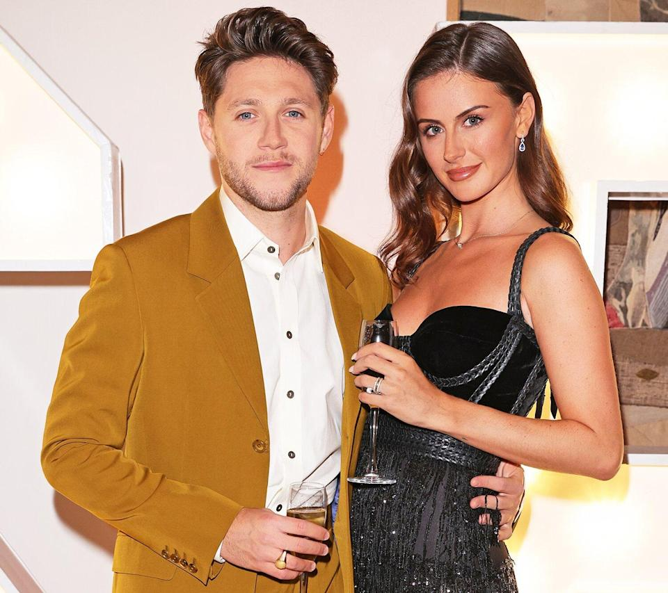 Niall Horan and Mia Woolley attend the Horan & Rose Show: Modest! Golf co-founder Niall Horan and Justin Rose brought the world of music and sport together at The Grove, presenting an evening of entertainment to raise money for The Black Heart Foundation on September 03, 2021 in Watford, England.