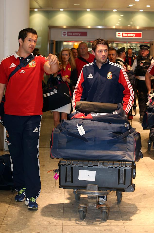 British and Irish Lions coach Andy Farrell (left) , arrives at Heathrow Airport, following their Test series triumph against Australia, just hours before the England cricket team pick up the baton.