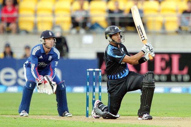 Ross Taylor of New Zealand bats while Jos Buttler of England looks on during the third Twenty20 International match between New Zealand and England at Westpac Stadium on February 15, 2013 in Wellington, New Zealand.  (Photo by Hagen Hopkins/Getty Images)