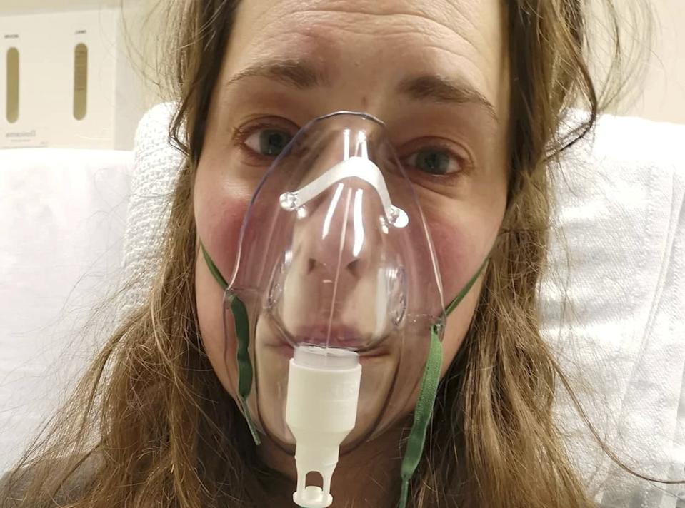 Mum-of-two Jess Marchbank, 33, shown here in hospital, is still struggling almost six months on. (SWNS)