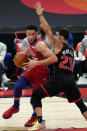 Philadelphia 76ers guard Ben Simmons (25) drives around Toronto Raptors guard Fred VanVleet (23) during the first half of an NBA basketball game Sunday, Feb. 21, 2021, in Tampa, Fla. (AP Photo/Chris O'Meara)