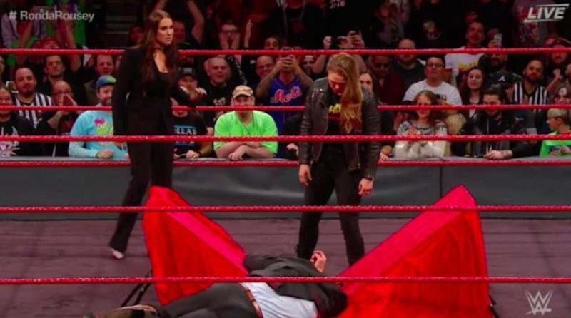 Watch: Ronda Rousey Tosses Triple H Through A Table, Gets