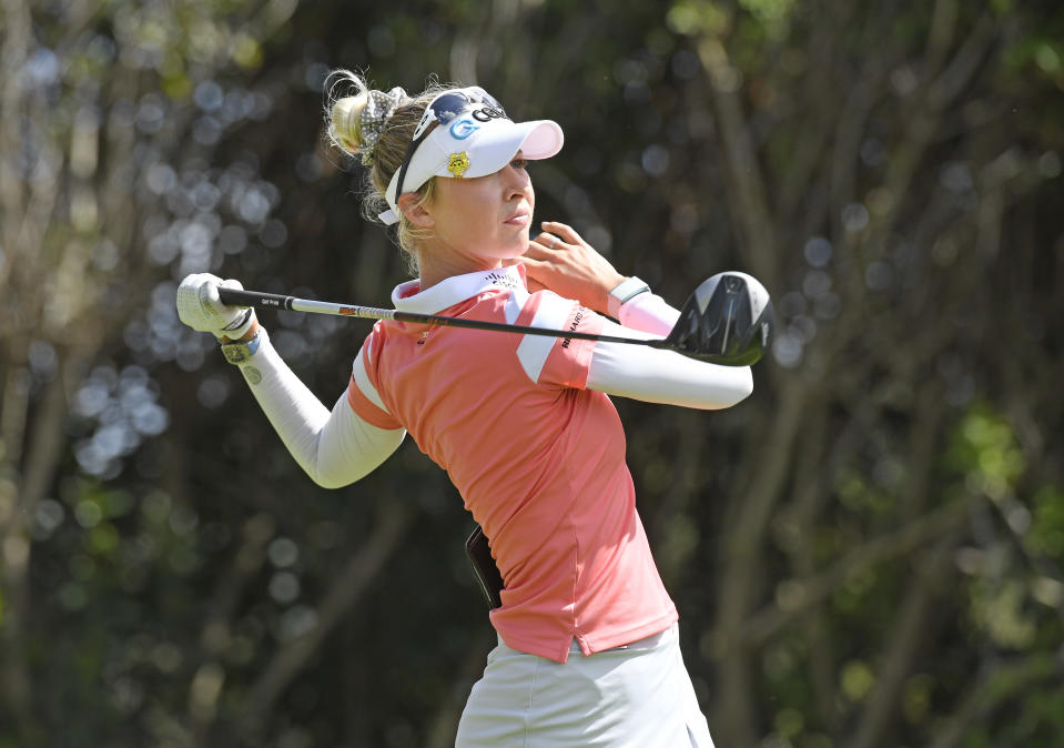 Nelly Korda plays a tee shot on the eighth hole during the final round of the Gainbridge LPGA golf tournament Sunday, Feb. 28, 2021, in Orlando, Fla. (AP Photo/Stan Badz)