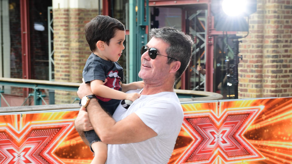 Simon Cowell and son Eric Cowell attending X Factor filming in 2017. (Photo by Ian West/PA Images via Getty Images)