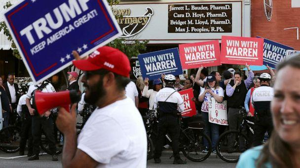 PHOTO: Supporters of resident Donald Trump and Sen. Elizabeth Warren rally on opposite corners near the perimeter of the fourth Democratic presidential debate Oct. 14, 2019 in Westerville, Ohio. (Chip Somodevilla/Getty Images)
