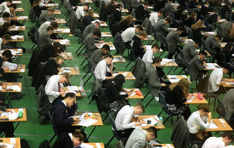 File photo dated 09/01/17 of students sitting their exams. Students in the UK are continuing to lag behind their peers from tiny European countries such as Estonia and Finland when it comes to maths, reading and science, a bellwether study of global education trends has suggested.