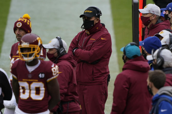 Washington Football Team head coach Ron Rivera, center, on the sidelines during the first half of an NFL football game against Dallas Cowboys, Sunday, Oct. 25, 2020, in Landover, Md. (AP Photo/Susan Walsh)