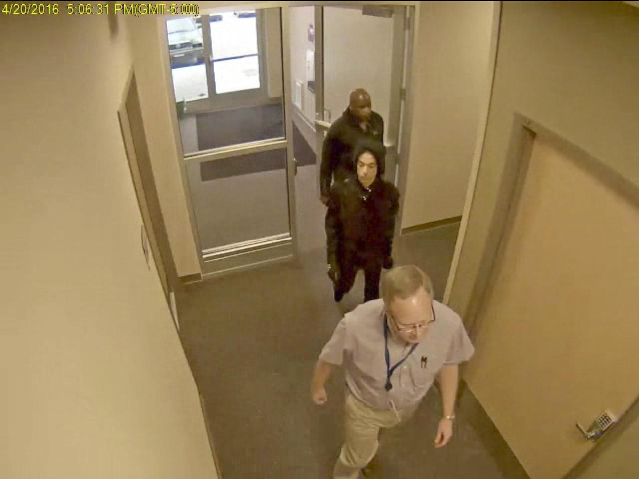 <p> In this image made from surveillance video provided Thursday, April 19, 2018, by the Carver County Sheriff's Office, as part of an investigative file into Prince's death, the superstar, center, enters a clinic of Dr. Michael Todd Schulenberg on April 20, 2016, the day before he was found dead of an accidental fentanyl overdose. The doctor is not facing criminal charges and his attorney says he had no role in Prince's death. (Carver County Sheriff's Office via AP) </p>