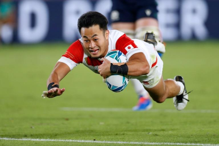 Japan's Kenki Fukuoka, seen here scoring against Scotland at last year's World Cup, will not be going to the delayed Olympics