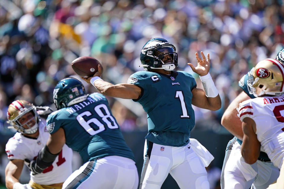 Philadelphia Eagles quarterback Jalen Hurts (1) looks to pass during the first half of an NFL football game against the San Francisco 49ers on Sunday, Sept. 19, 2021, in Philadelphia. (AP Photo/Matt Rourke)