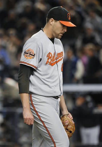 Baltimore Orioles relief pitcher Jim Johnson leaves the field after the ninth inning of Game 3 of the Orioles' American League division baseball series against the New York Yankees on Wednesday, Oct. 10, 2012, in New York. (AP Photo/Bill Kostroun)