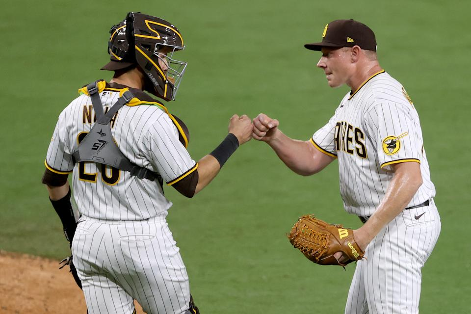 SAN DIEGO, CALIFORNIA - MAY 03: Austin Nola #26 congratulates Mark Melancon #33 of the San Diego Padres after defeating the Pittsburgh Pirates 2-0 in  a game at PETCO Park on May 03, 2021 in San Diego, California. (Photo by Sean M. Haffey/Getty Images)
