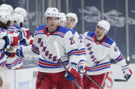 New York Rangers' Libor Hajek (25) celebrates with teammates after scoring during the second period of an NHL hockey game against the New York Islanders Sunday, April 11, 2021, in Uniondale, N.Y. (AP Photo/Frank Franklin II)