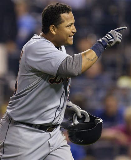 Detroit Tigers' Miguel Cabrera points to fans after hitting a solo home run off Kansas City Royals starting pitcher Bruce Chen during the sixth inning of a baseball game at Kauffman Stadium in Kansas City, Mo., Monday, Oct. 1, 2012. (AP Photo/Orlin Wagner)