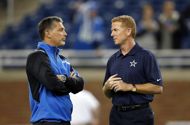 Detroit Lions head coach Jim Schwartz, left, talks with Dallas Cowboys head coach Jason Garrett during warmups before an NFL football game in Detroit, Sunday, Oct. 27, 2013. (AP Photo/Paul Sancya)