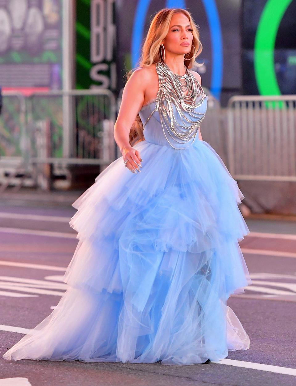<p>A dressed-up Jennifer Lopez films a segment for ABC's <em>Dick Clark's New Year's Rockin' Eve</em> on Wednesday night in N.Y.C.'s Times Square.</p>
