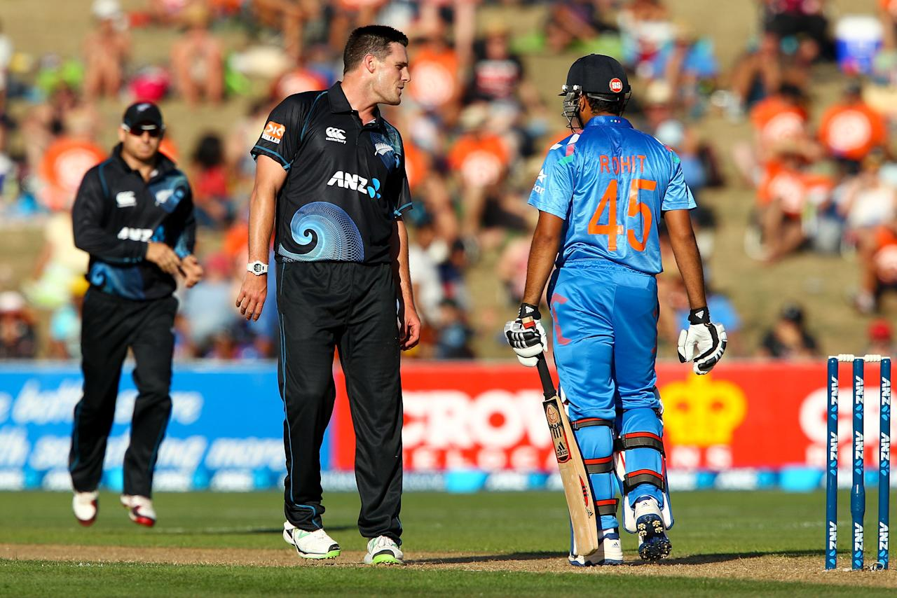 NAPIER, NEW ZEALAND - JANUARY 19:  Mitchell McClenaghan of New Zealand exchanges words with Rohit Sharma of India during the first One Day International match between New Zealand and India at McLean Park on January 19, 2014 in Napier, New Zealand.  (Photo by Hagen Hopkins/Getty Images)
