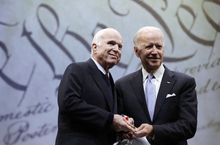 FILE - In this Oct. 16, 2017, file photo Sen. John McCain, R-Ariz., receives the Liberty Medal from Chair of the National Constitution Center's Board of Trustees, former Vice President Joe Biden, in Philadelphia. Cindy McCain is going to bat for Biden, lending her voice to a video set to air on Tuesday, Aug. 18, 2020 during the Democratic National Convention programming focused on Biden's close friendship with her late husband, Sen. John McCain. (AP Photo/Matt Rourke, File)