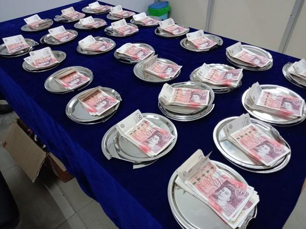 According to officials, the money was concealed 25 specially moulded steel plates. Photo/ANI