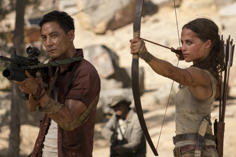 """FILE - This file image released by Warner Bros. Pictures shows Daniel Wu, left, and Alicia Vikander in a scene from """"Tomb Raider."""" """"Black Panther"""" has become the first film since 2000's """"Avatar"""" to top the weekend box office five straight weekends. According to studio estimates Sunday, March 18, 2018, """"Black Panther"""" grossed $27 million in ticket sales over the weekend, pushing its domestic haul to $605.4 million. The rebooted """"Tomb Raider,"""" starring Vikander, opened with $23.5 million. (Ilze Kitshoff/Warner Bros. Pictures via AP, File)"""