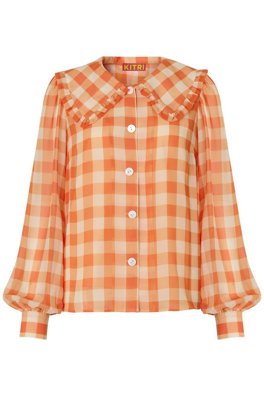 """<p><a class=""""link rapid-noclick-resp"""" href=""""https://kitristudio.com/products/laura-frill-collar-gingham-top?_pos=3&_sid=197fba16e&_ss=r"""" rel=""""nofollow noopener"""" target=""""_blank"""" data-ylk=""""slk:SHOP NOW"""">SHOP NOW</a></p><p>Buy into two timeless trends at once with Kitri's statement collar gingham shirt. Tuck into an A-line denim skirt or jeans for a laidback weekend look.</p><p>Frill collar shirt, £115, <a href=""""https://kitristudio.com/products/laura-frill-collar-gingham-top?_pos=3&_sid=197fba16e&_ss=r"""" rel=""""nofollow noopener"""" target=""""_blank"""" data-ylk=""""slk:Kitri"""" class=""""link rapid-noclick-resp"""">Kitri</a></p>"""