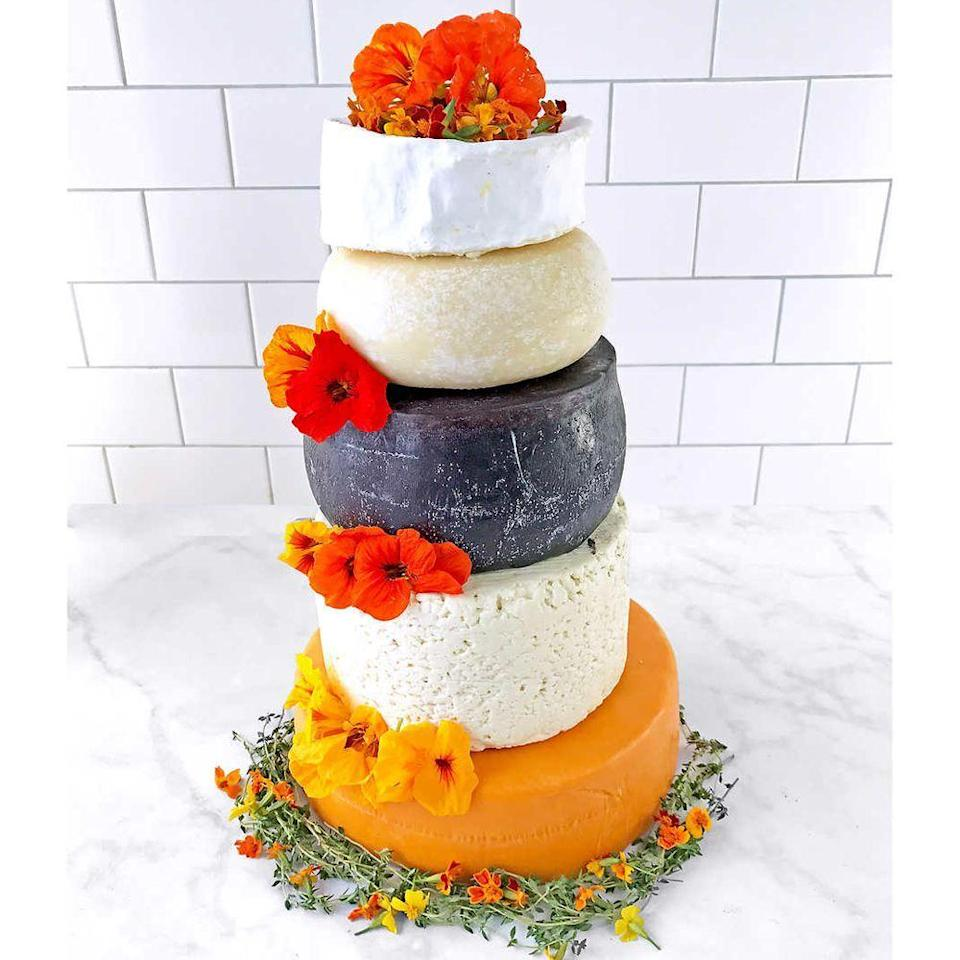 """<p>costco.com</p><p><strong>$439.99</strong></p><p><a href=""""https://www.costco.com/Sid-Wainer-2526-Son-Cheese-Lover-Artisan-Wedding-Cake.product.100420818.html"""" rel=""""nofollow noopener"""" target=""""_blank"""" data-ylk=""""slk:Shop Now"""" class=""""link rapid-noclick-resp"""">Shop Now</a></p><p>Here comes the brie, here comes the brie ... find out just how delicious this <a href=""""https://www.bestproducts.com/lifestyle/a26098686/costco-sid-wainer-and-son-5-tier-wedding-cheese-cake/"""" rel=""""nofollow noopener"""" target=""""_blank"""" data-ylk=""""slk:5-Tier Cheese Wedding Cake"""" class=""""link rapid-noclick-resp"""">5-Tier Cheese Wedding Cake</a> really is here. </p>"""