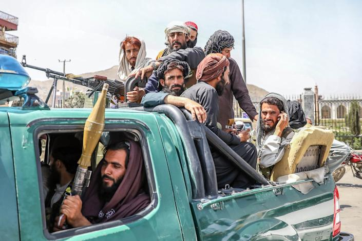 Taliban fighters in a pickup truck in Kabul on Monday.