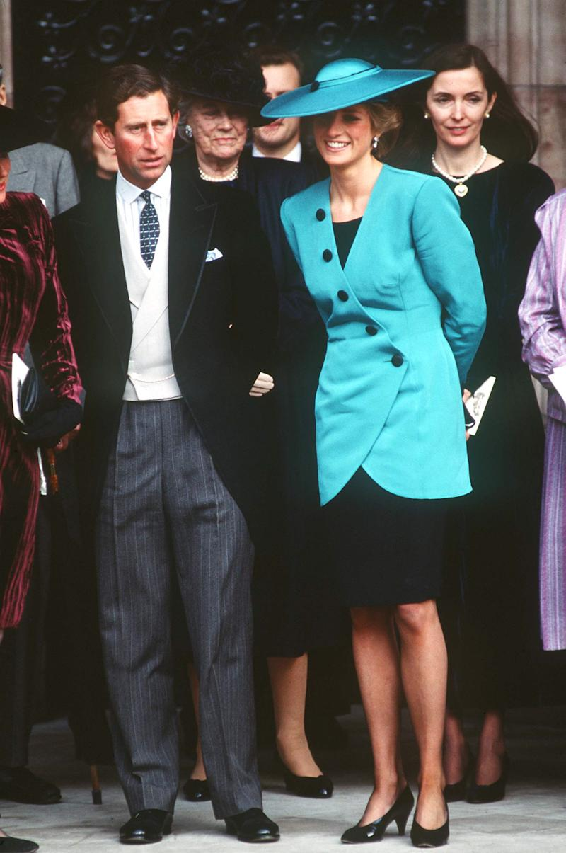 HEREFORD, UNITED KINGDOM - OCTOBER 08: Prince Charles And Princess Diana At The Society Wedding Of Miss Camilla Dunne To The Honourable Rupert Soames At Hereford Cathedral. Fashion Designer Catherine Walker Stands Behind The Princess. (Photo by Tim Graham Photo Library via Getty Images)