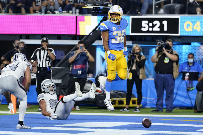 Los Angeles Chargers running back Austin Ekeler, right, reacts after scoring a touchdown during the second half of an NFL football game against the Las Vegas Raiders, Monday, Oct. 4, 2021, in Inglewood, Calif. (AP Photo/Marcio Jose Sanchez)