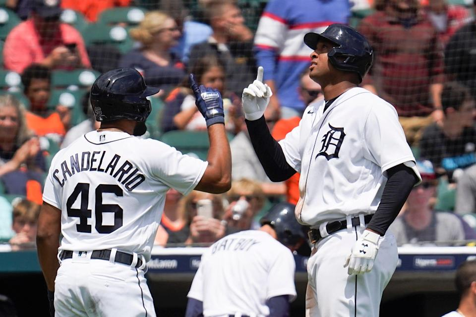 Detroit Tigers' Jonathan Schoop, right, celebrates his solo home run with Jeimer Candelario (46) in the fifth inning of a baseball game against the St. Louis Cardinals in Detroit, Wednesday, June 23, 2021.