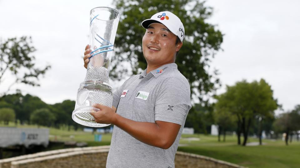 Kyoung-Hoon Lee, of South Korea, holds the trophy on the 18th green after winning the AT&T Byron Nelson golf tournament. (AP Photo/Ray Carlin)