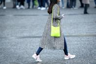 <p>Millennial or not, light pink sneakers look especially fresh against dark-rinse skinnies and a neon bag.</p>