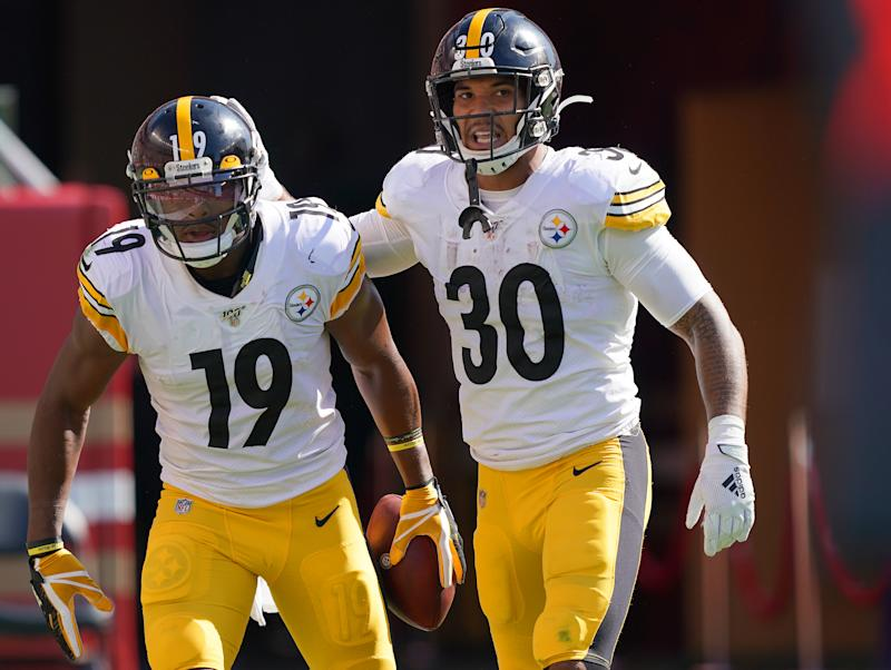 The Steelers will be without receiver JuJu Smith-Schuster, left, and running back James Conner in Sunday's game against the Bengals. (Thearon W. Henderson/Getty Images)